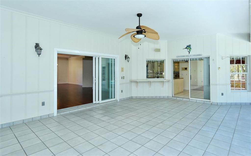 The kitchen bar and pass through window are an added bonus for entertaining - Single Family Home for sale at 1636 Liscourt Dr, Venice, FL 34292 - MLS Number is A4429524