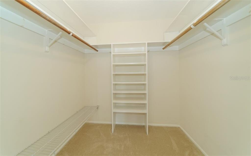 Master walk-in closet. - Single Family Home for sale at 310 Bayview Pkwy, Nokomis, FL 34275 - MLS Number is A4430065