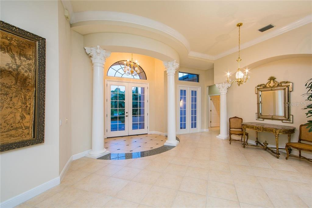 Elegant entry. Twelve foot ceilings. Corinthian columns. Crown molding. - Single Family Home for sale at 7107 Whitemarsh Cir, Lakewood Ranch, FL 34202 - MLS Number is A4430156