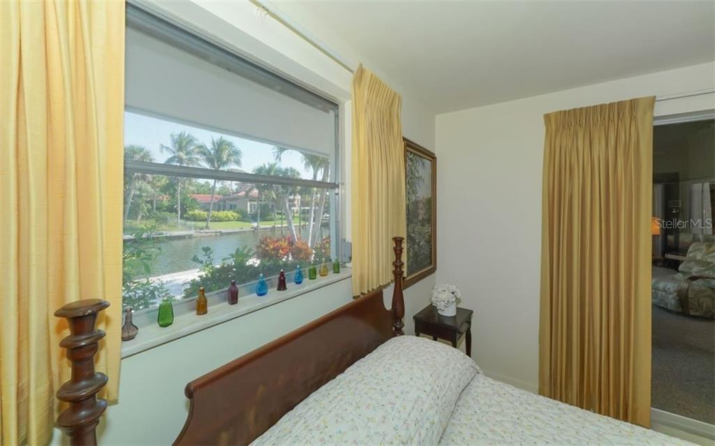 Guest Bedroomhas Views of Canal - Single Family Home for sale at 935 Contento St, Sarasota, FL 34242 - MLS Number is A4431223