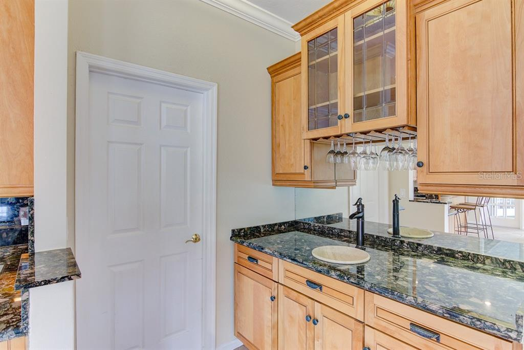 Your wet bar with lots of storage space - Single Family Home for sale at 7945 Palmer Blvd, Sarasota, FL 34240 - MLS Number is A4431318