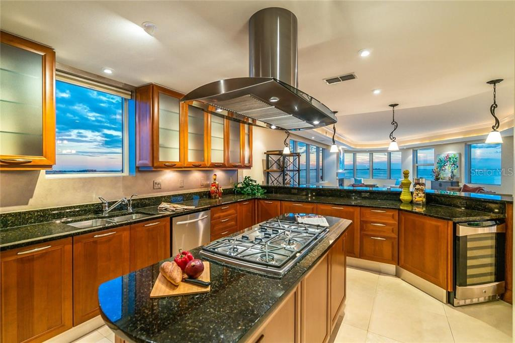 Your kitchen boasts a 5-burner gas grill, ample cabinetry and counter space, wine fridge AND VIEWS!!! - Condo for sale at 128 Golden Gate Pt #902a, Sarasota, FL 34236 - MLS Number is A4433296
