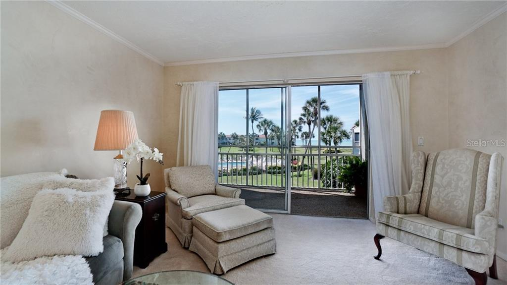 Living room walls have Venetian plaster finish done by master painter, smooth as silk! - Condo for sale at 7145 Gulf Of Mexico Dr #24, Longboat Key, FL 34228 - MLS Number is A4433880