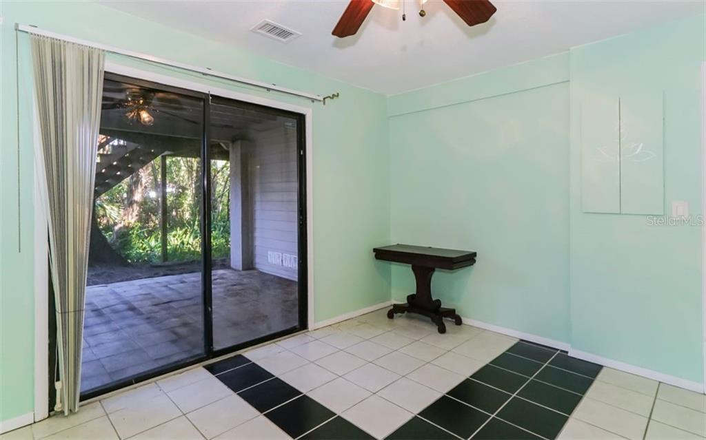 DEN/OFFICE WITH PATIO THROUGH SLIDERS - Single Family Home for sale at 1225 Sea Plume Way, Sarasota, FL 34242 - MLS Number is A4434060