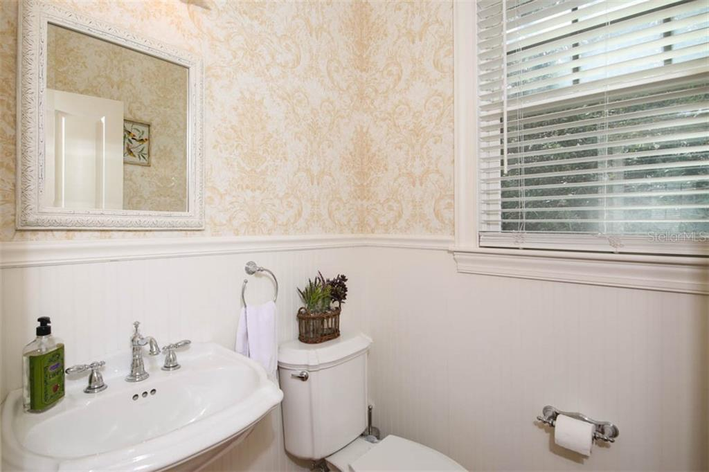Powder room. - Single Family Home for sale at 7153 Hawks Harbor Cir, Bradenton, FL 34207 - MLS Number is A4434661