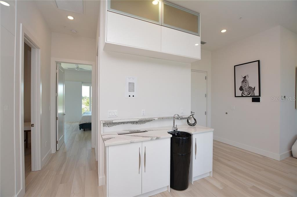 The wet bar is pre-wired for a television. - Condo for sale at 254 S Polk Dr #102, Sarasota, FL 34236 - MLS Number is A4434803