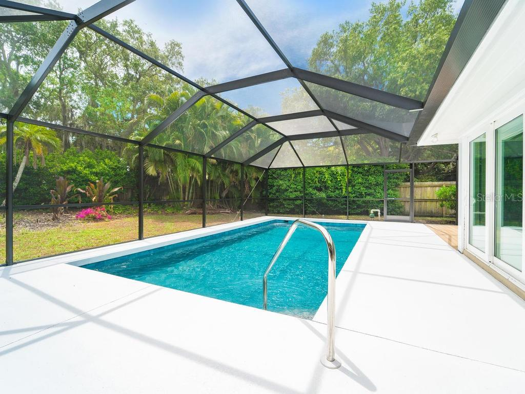 Pool Deck leading to Master Suite. - Single Family Home for sale at 4773 Pine Harrier Dr, Sarasota, FL 34231 - MLS Number is A4436182