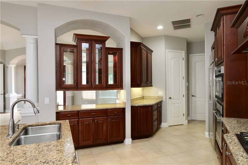 The kitchen showing the serving area and closet pantry - Single Family Home for sale at 902 Riviera Dunes Way, Palmetto, FL 34221 - MLS Number is A4436277