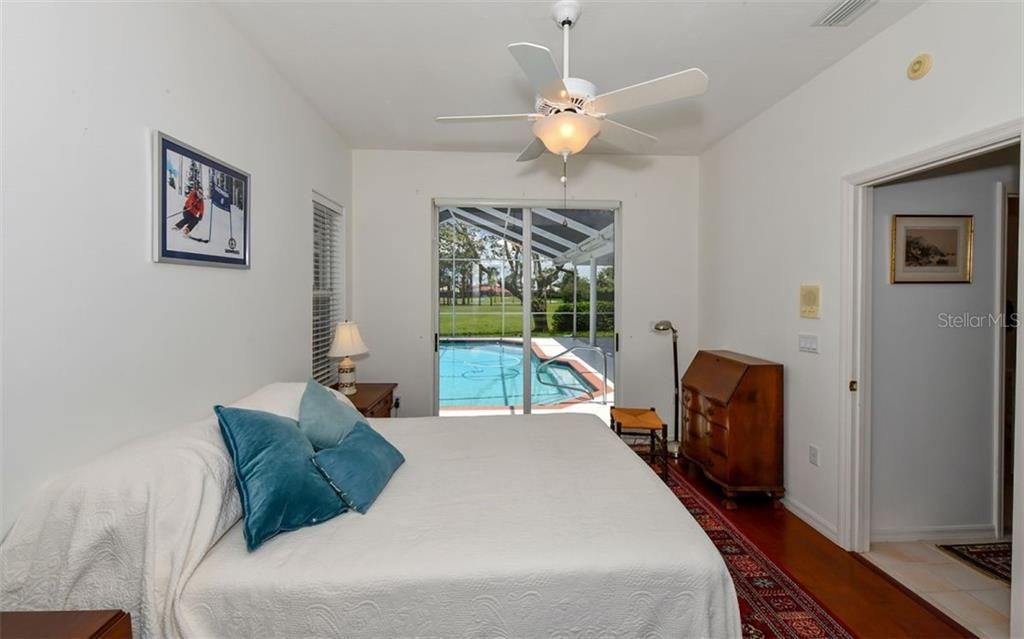 Bedroom 2 - Single Family Home for sale at 5401 Downham Meadows, Sarasota, FL 34235 - MLS Number is A4436577