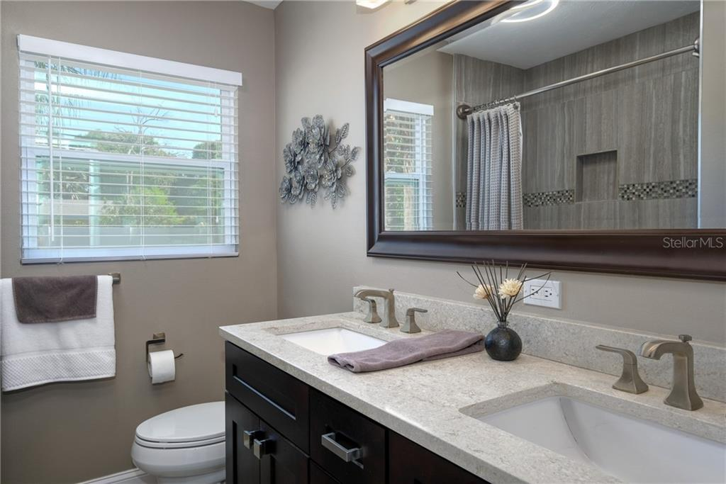 Dual sinks, quartz counter tops.  All plumbing has been updated in the entire home. - Single Family Home for sale at 2209 Shawnee St, Sarasota, FL 34231 - MLS Number is A4436751