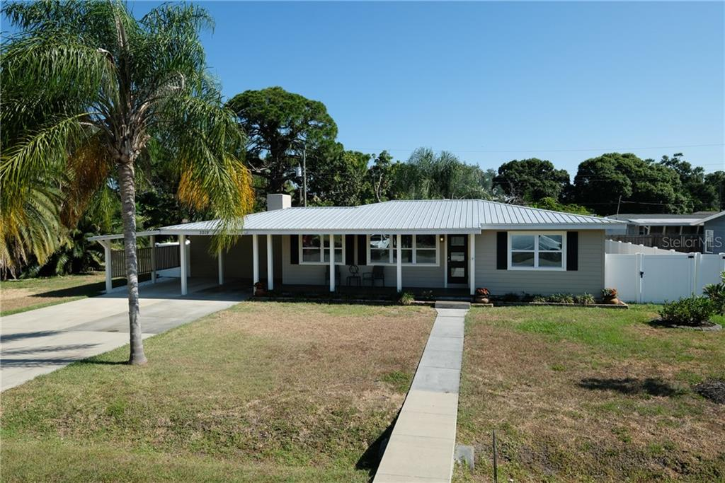Walk up to the welcoming covered front porch. - Single Family Home for sale at 2209 Shawnee St, Sarasota, FL 34231 - MLS Number is A4436751
