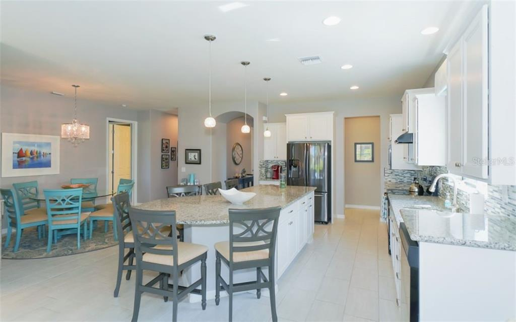 Expansive Kitchen and Dining area - Single Family Home for sale at 13337 Pacchio St, Venice, FL 34293 - MLS Number is A4437569