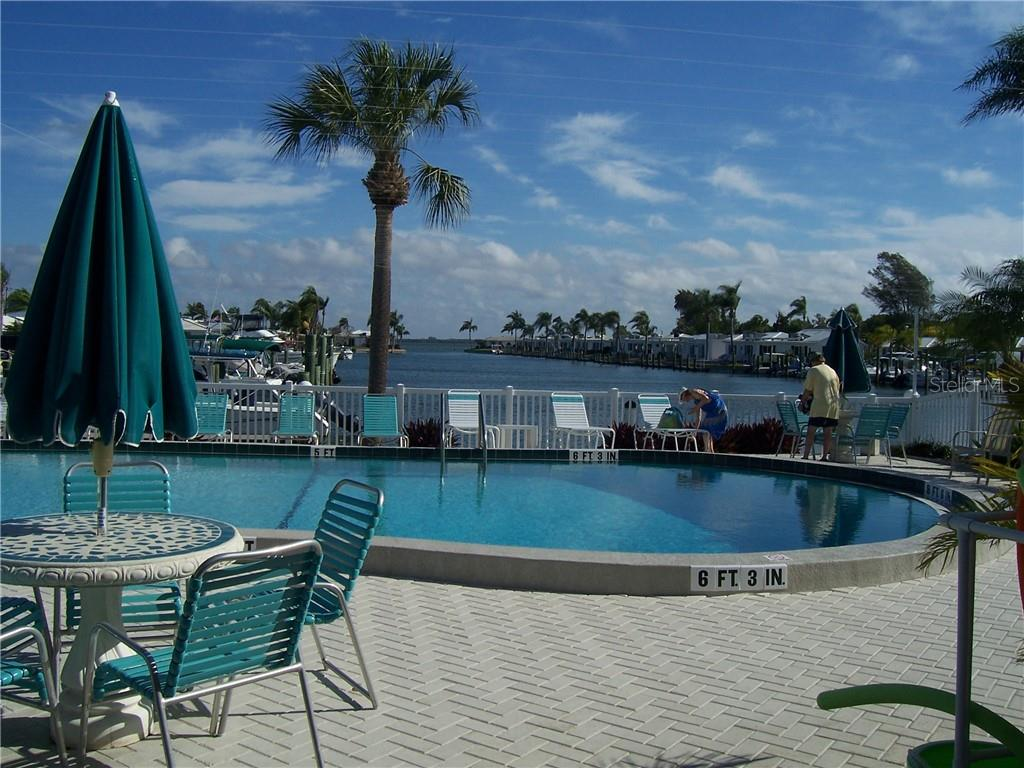 Marina and pool view from the clubhouse - Villa for sale at 717 Spanish Dr N, Longboat Key, FL 34228 - MLS Number is A4438337