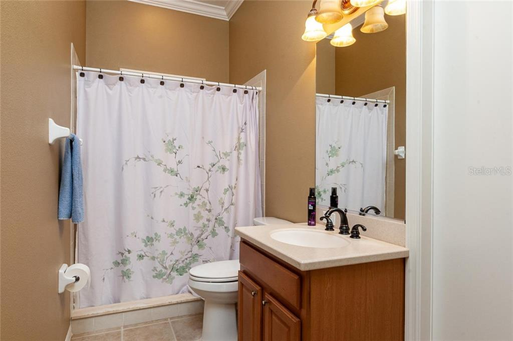 Ground floor pool bathroom - Single Family Home for sale at 13818 Nighthawk Ter, Lakewood Ranch, FL 34202 - MLS Number is A4438487