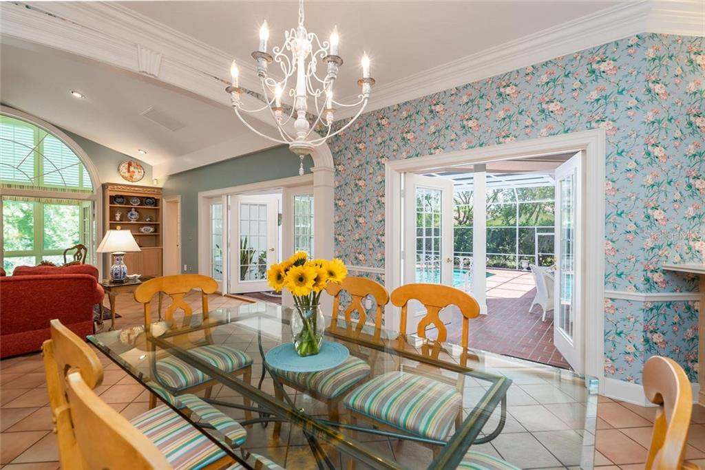 Informal Eating Space right off the kitchen with great views through two sets of Double French doors overlooking the pool lanai and the beautiful lush Floridian backdrop! - Single Family Home for sale at 3702 Beneva Oaks Blvd, Sarasota, FL 34238 - MLS Number is A4438878
