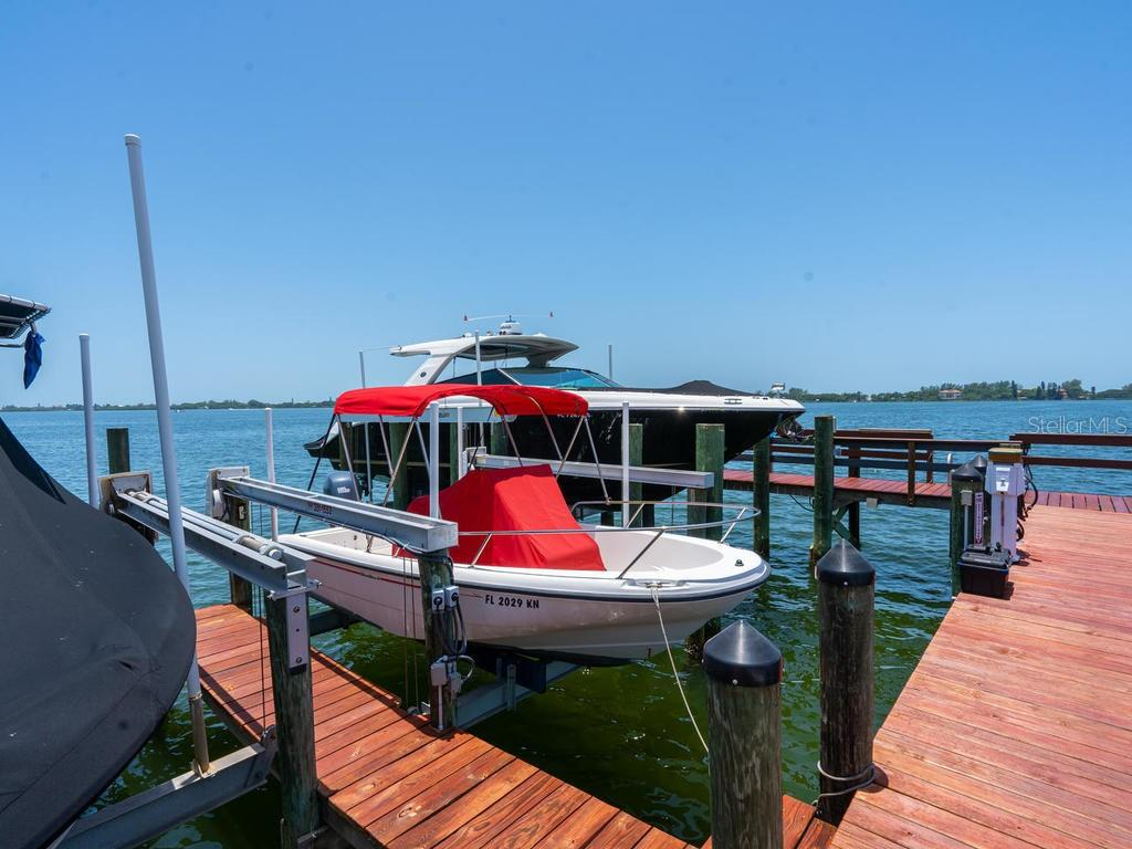 Slip and boat lift deeded to this property - Single Family Home for sale at 158 Puesta Del Sol, Osprey, FL 34229 - MLS Number is A4439362