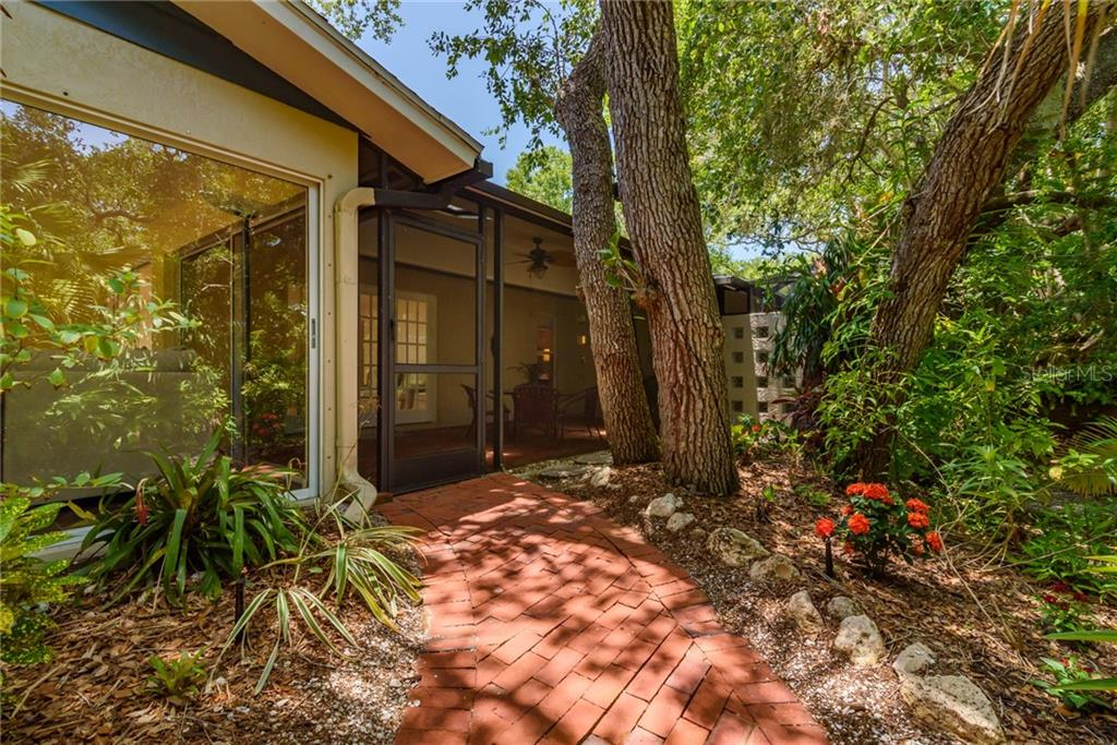 Brick pathway to lanai - Single Family Home for sale at 8511 Heron Lagoon Cir, Sarasota, FL 34242 - MLS Number is A4439489