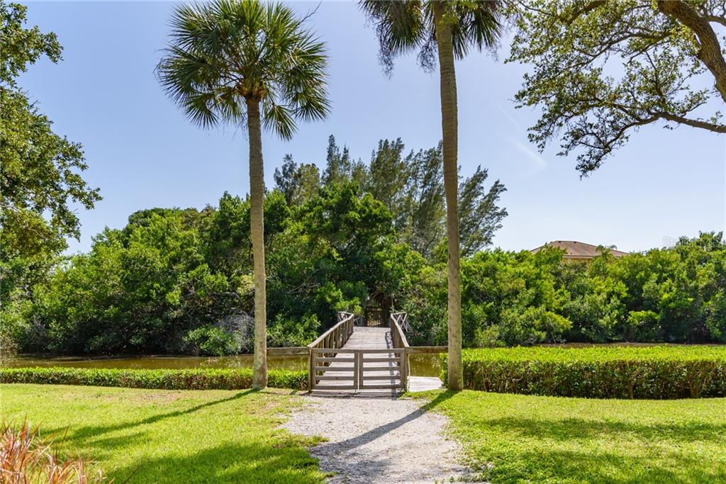 Foot bridge to Gulf front lot & Cabana on beach - Single Family Home for sale at 8511 Heron Lagoon Cir, Sarasota, FL 34242 - MLS Number is A4439489