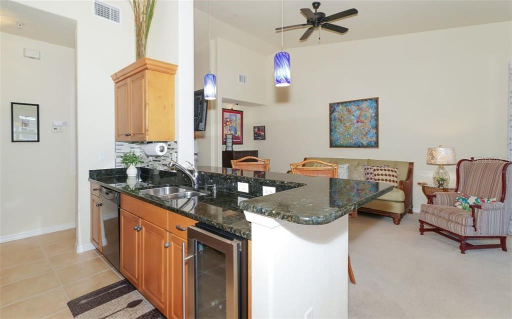 Wine refrigeration, granite counters and new pendant lights. - Condo for sale at 200 San Lino Cir #233, Venice, FL 34292 - MLS Number is A4440138
