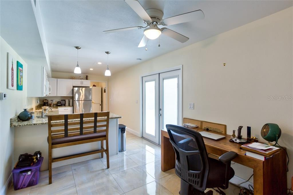 In Law Apt Kitchen and breakfast bar/desk area. - Single Family Home for sale at 2322 Cadillac St, Sarasota, FL 34231 - MLS Number is A4440841