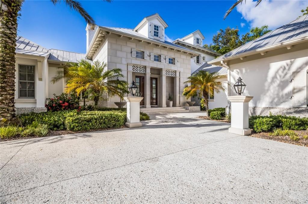 Builder | Michael Walker, Architect | John Cooney, Landscape | Richard Anderson Exterior comprised of limestone with a two foot base of tabby. - Single Family Home for sale at 1522 N Lake Shore Dr, Sarasota, FL 34231 - MLS Number is A4442286
