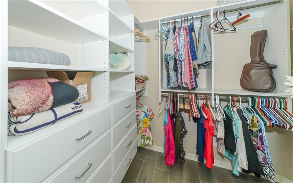 Master closet with abundant built-in cabinetry. - Single Family Home for sale at 114 Padova Way #52, North Venice, FL 34275 - MLS Number is A4442496