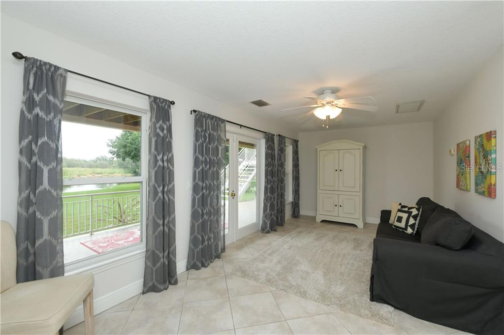 Lower Level In-Law Suite Living Room - Single Family Home for sale at 6532 Lincoln Rd, Bradenton, FL 34203 - MLS Number is A4444732