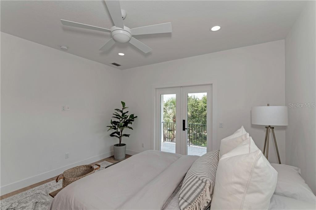 Upstairs Master Suite with Private Balcony - Single Family Home for sale at 5035 Sandy Beach Ave, Sarasota, FL 34242 - MLS Number is A4445640