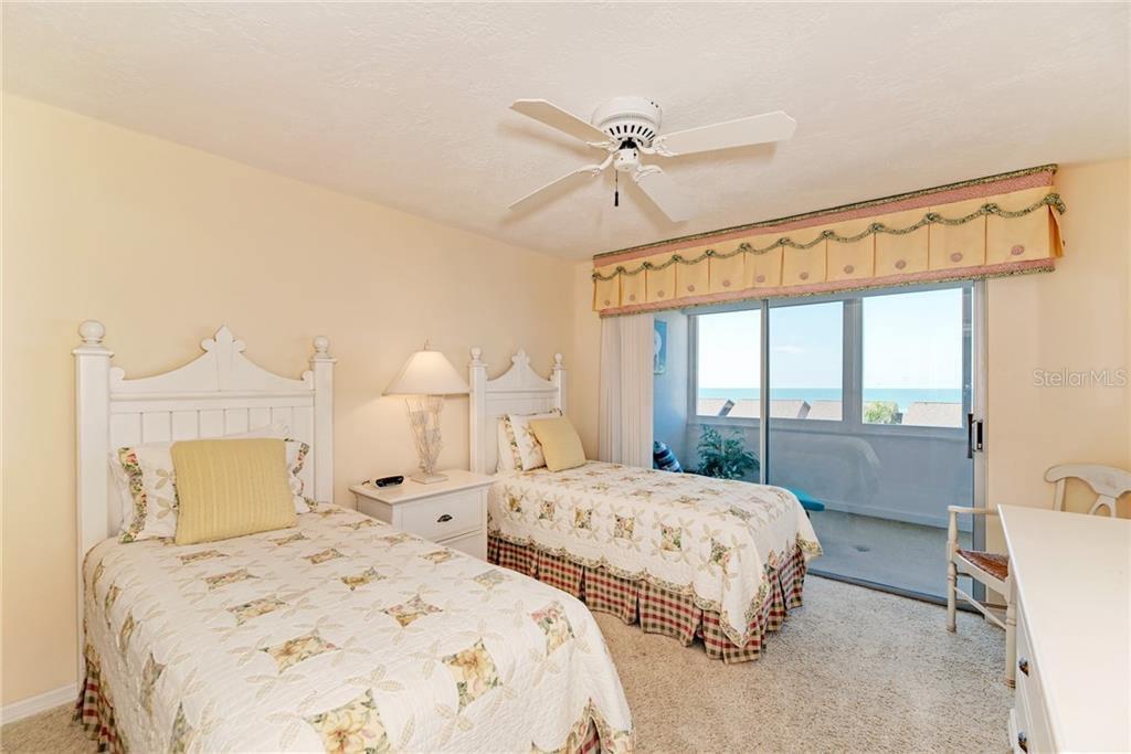 Bedroom 2 with its own lanai access - Condo for sale at 1080 W Peppertree Ln #406a, Sarasota, FL 34242 - MLS Number is A4446520