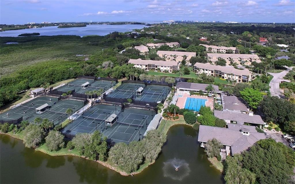 Landings Club, fitness room, community pool, jacuzzi and tennis facility - Townhouse for sale at 1713 Starling Dr #1713, Sarasota, FL 34231 - MLS Number is A4446790