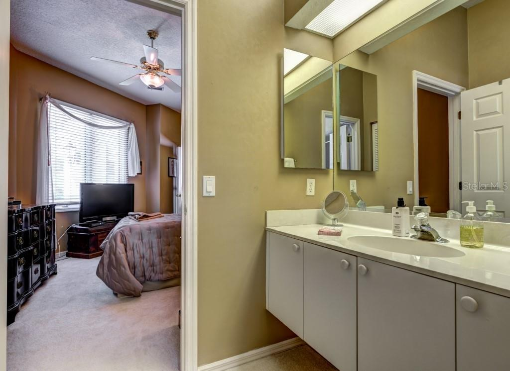 Second ensuite bathroom offers privacy and convenience. - Single Family Home for sale at 8727 53rd Ter E, Bradenton, FL 34211 - MLS Number is A4447005