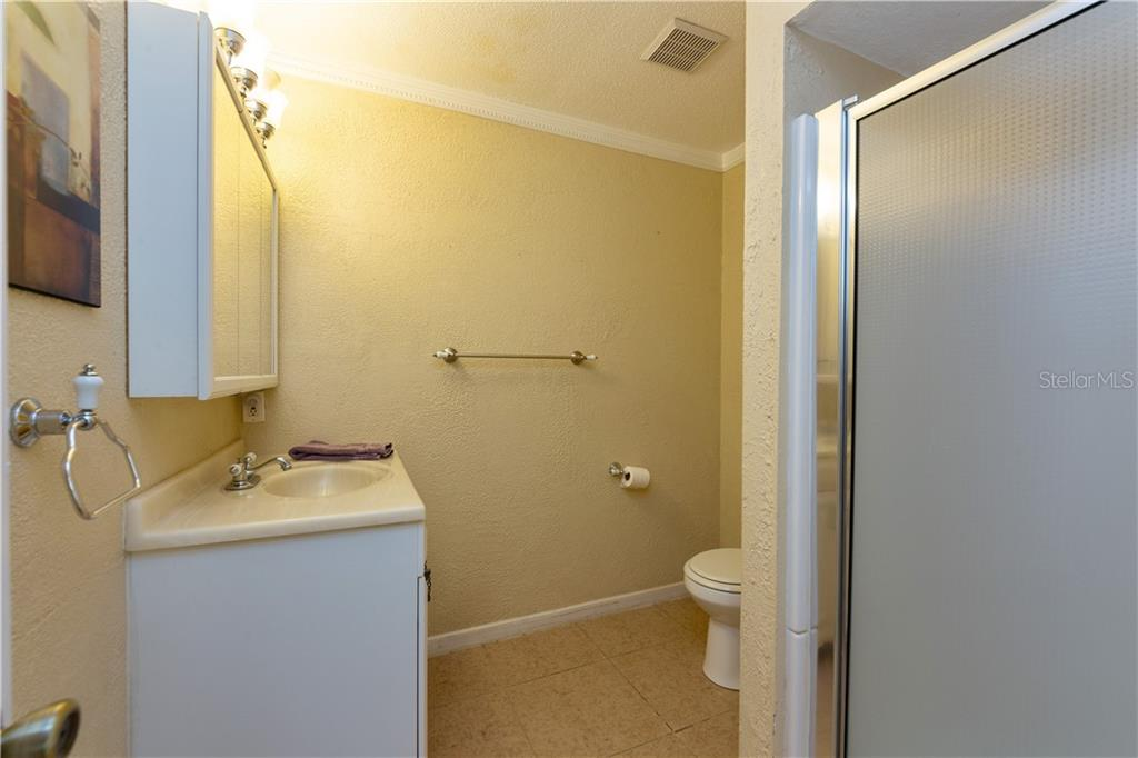 Hall bath next to 2nd bedroom - Duplex/Triplex for sale at 311 Coronado Rd, Venice, FL 34293 - MLS Number is A4449208