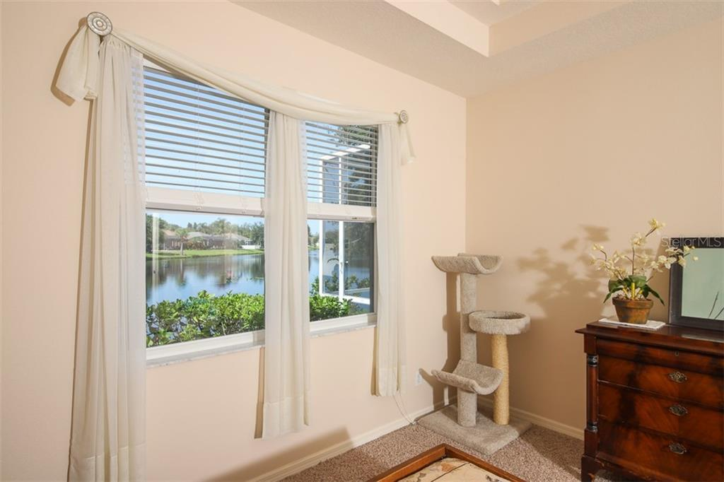 Sorry; the piano does not convey but as you can see, there is plenty of room for a grand! - Single Family Home for sale at 5077 Creekside Trl, Sarasota, FL 34243 - MLS Number is A4449889