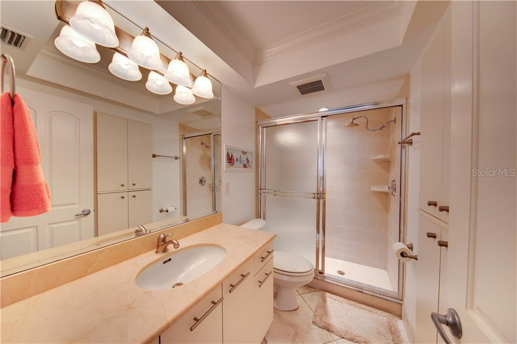 View of the ensuite master bathroom. - Condo for sale at 555 The Esplanade N #102, Venice, FL 34285 - MLS Number is A4450635