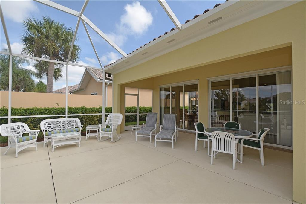 Generous lanai offers covered living & dining area and plenty of space to enjoy the sun. - Single Family Home for sale at 5799 Benevento Dr, Sarasota, FL 34238 - MLS Number is A4450677