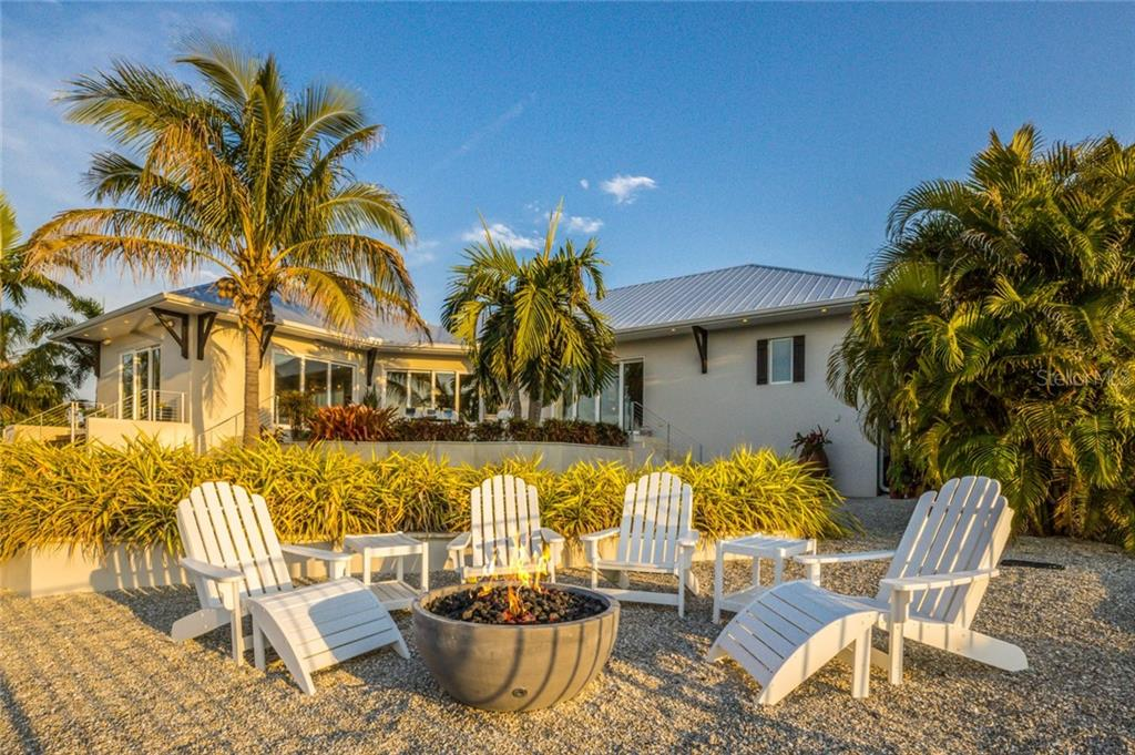 Single Family Home for sale at 629 Dundee Ln, Holmes Beach, FL 34217 - MLS Number is A4451248