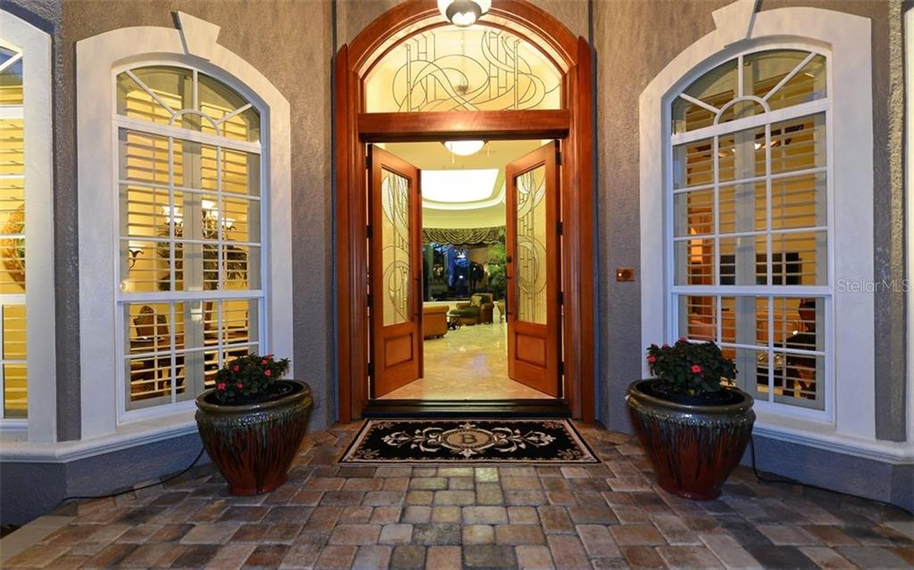 Elegant entry through double glass doors to spacious foyer. - Single Family Home for sale at 586 N Macewen Dr, Osprey, FL 34229 - MLS Number is A4451482
