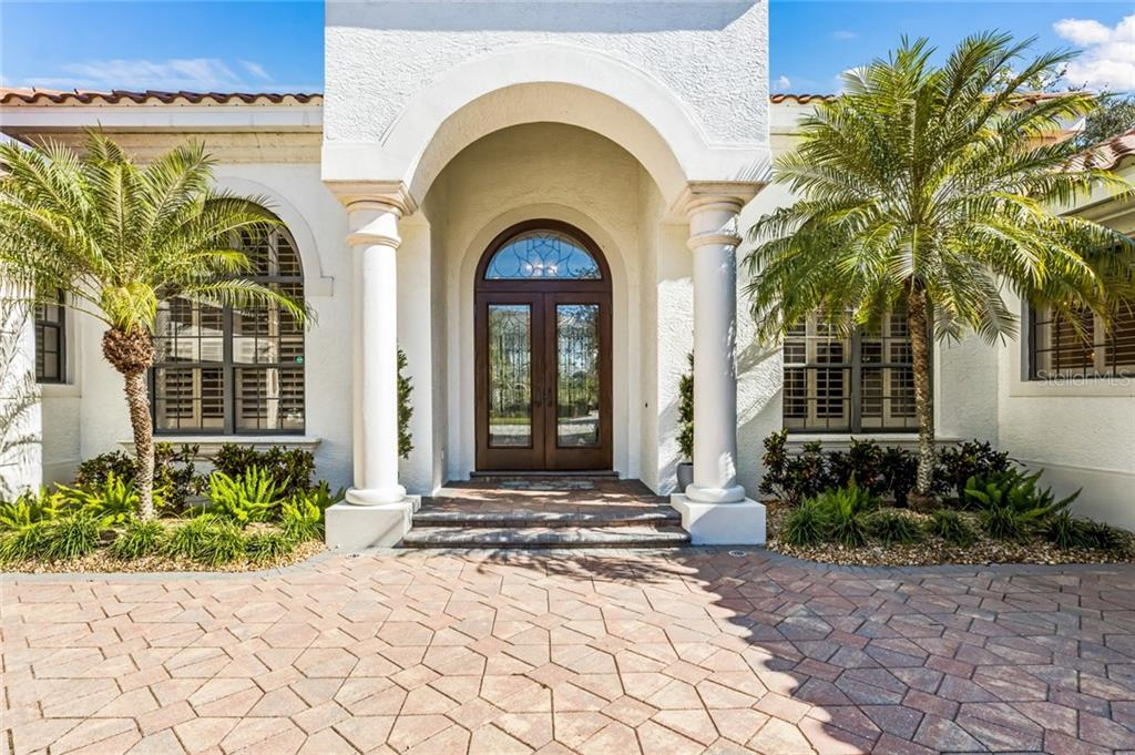 DOUBLE FRONT DOORS WITH TRANSON GLASS WINDOW. - Single Family Home for sale at 12551 Highfield Cir, Lakewood Ranch, FL 34202 - MLS Number is A4452079