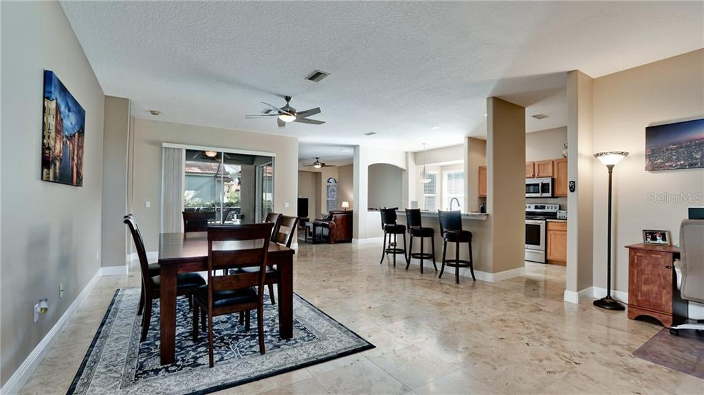 Single Family Home for sale at 7397 Featherstone Blvd, Sarasota, FL 34238 - MLS Number is A4452458