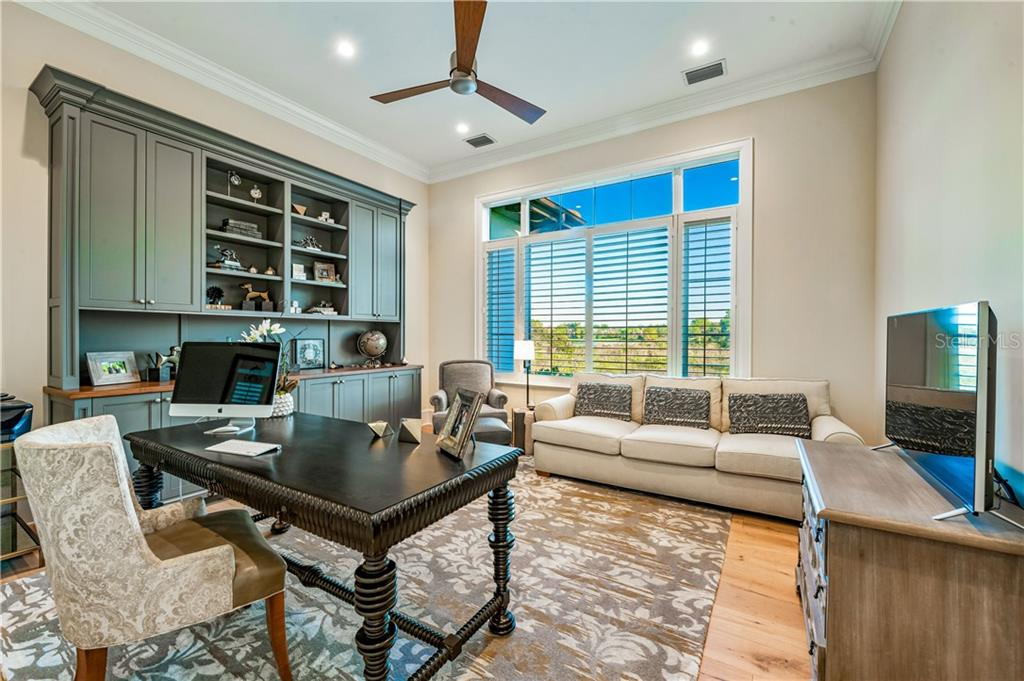 Home Office with Built In Cabinet by Master Wing. - Single Family Home for sale at 16119 Baycross Dr, Lakewood Ranch, FL 34202 - MLS Number is A4452632
