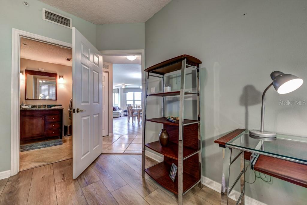 Bedroom two is smartly placed on the opposite side of the home from the owners suite giving privacy to all.  A great space for the remote executive if needed. - Condo for sale at 5420 Eagles Point Cir #204, Sarasota, FL 34231 - MLS Number is A4454318