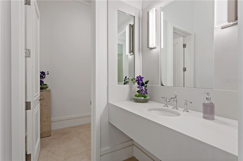 4 full baths plus this powder room with in-set mirrors and designer lighting. - Single Family Home for sale at 552 Eagle Watch Ln, Osprey, FL 34229 - MLS Number is A4454431