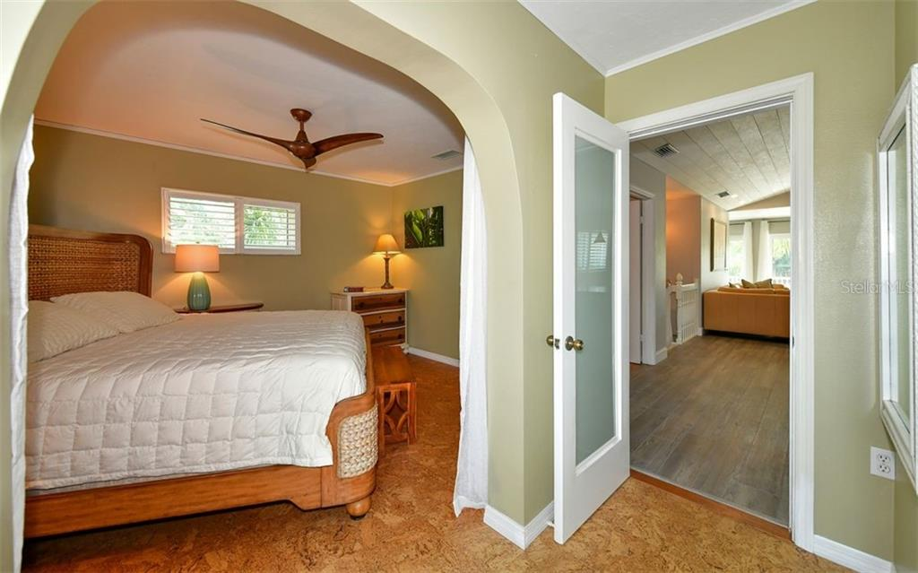 Upstairs master bedroom suite with cork flooring - Single Family Home for sale at 623 Avenida Del Norte, Sarasota, FL 34242 - MLS Number is A4454692