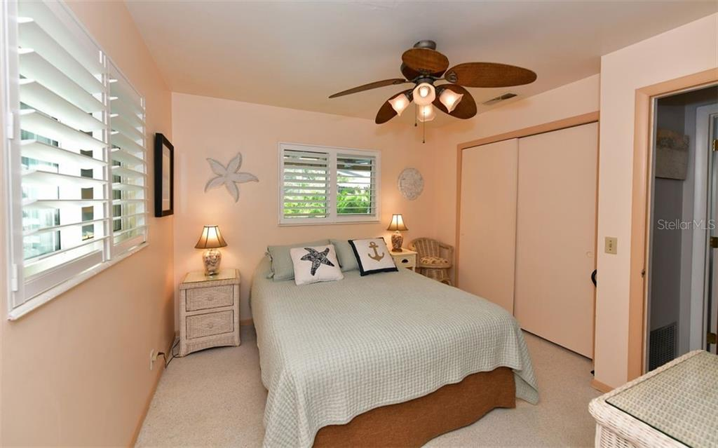 Guest room with view to pool area - Single Family Home for sale at 623 Avenida Del Norte, Sarasota, FL 34242 - MLS Number is A4454692