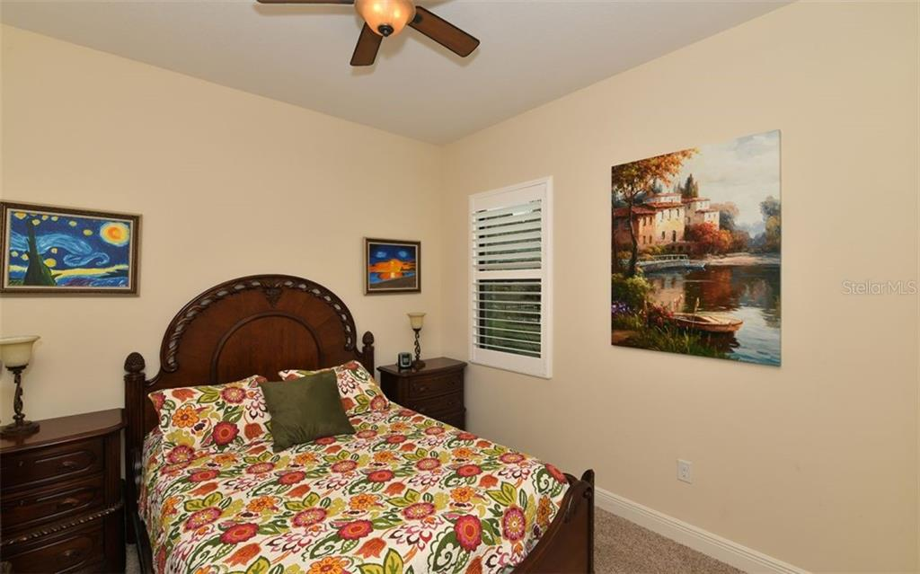 Bedroom 3 - Single Family Home for sale at 8260 Larkspur Cir, Sarasota, FL 34241 - MLS Number is A4455087
