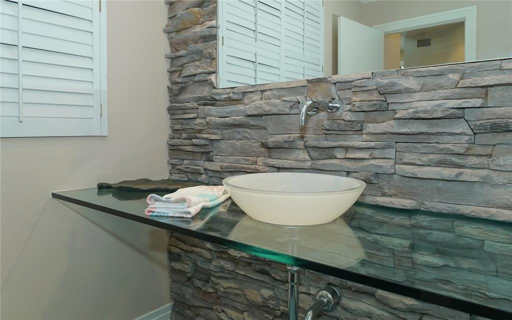 Eyecatching stone/glass combo in half bath. - Condo for sale at 3994 Hamilton Club Cir #18, Sarasota, FL 34242 - MLS Number is A4455281