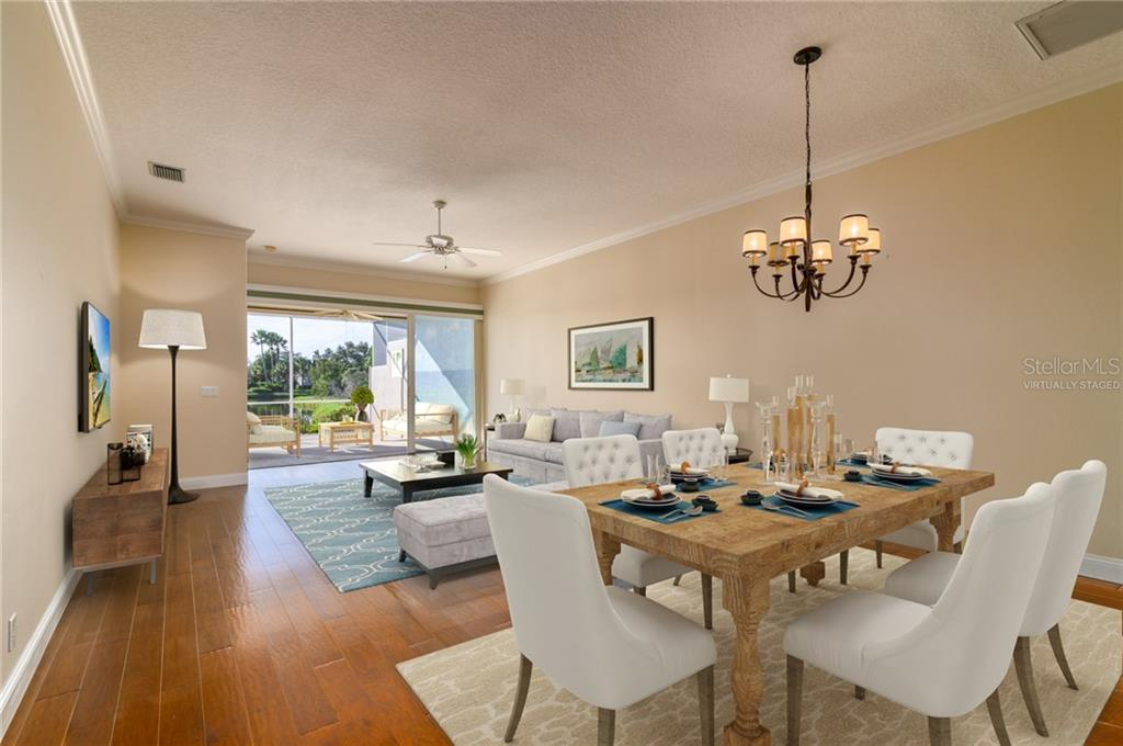 Dining / Living Room Virtually Staged - Villa for sale at 4560 Samoset Dr, Sarasota, FL 34241 - MLS Number is A4455487