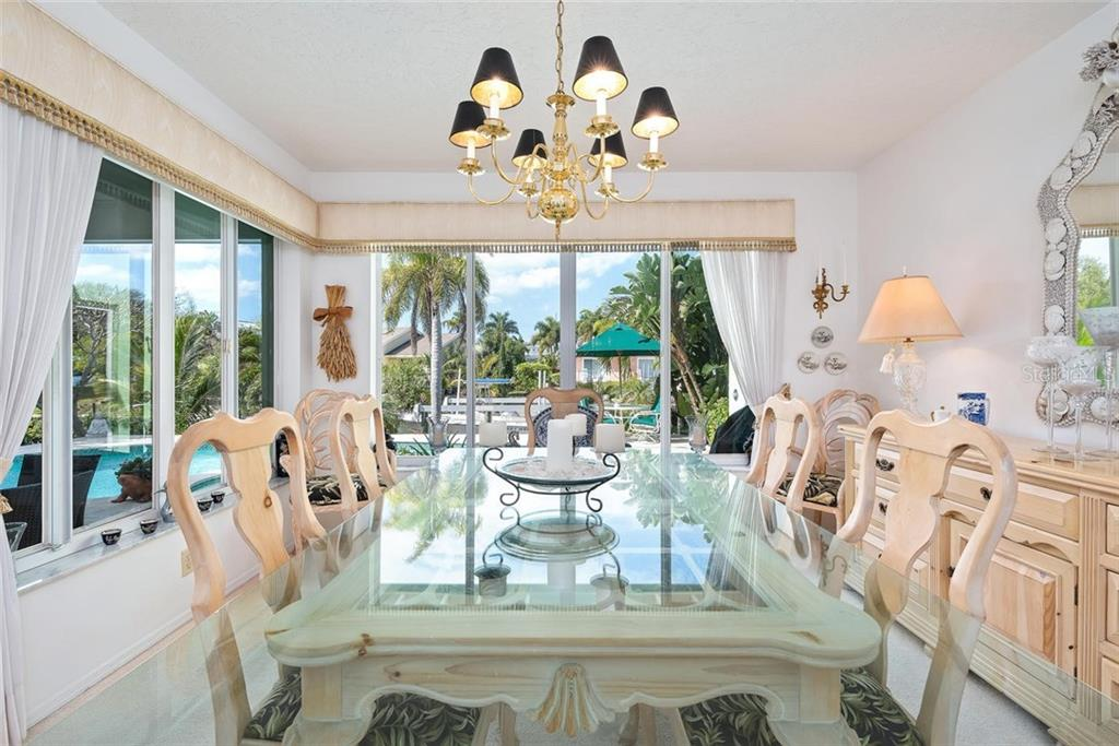 Dining room with waterviews - Single Family Home for sale at 609 N Point Dr, Holmes Beach, FL 34217 - MLS Number is A4455659