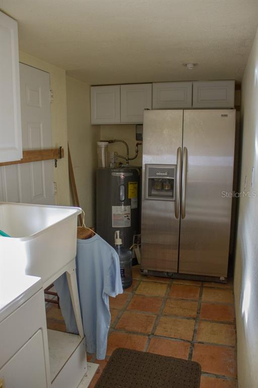 LAUNDRY ROOM FRIDGE AND 2ND EXIT TO PATIO - Single Family Home for sale at 4828 Greenleaf Rd, Sarasota, FL 34233 - MLS Number is A4456695
