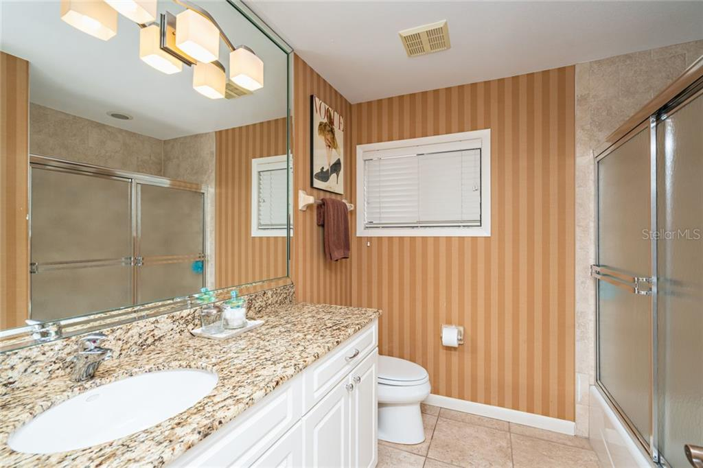 Large guest bathroom. - Single Family Home for sale at 4557 Camino Real, Sarasota, FL 34231 - MLS Number is A4457740